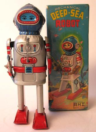 Battery operated tin toy robot appraisals, alps rocket man robot for sale, vintage space toys collections for sale, rare space toys for sale,  Japan tin robots price guide friction cars friction robots friction toy cars antique toy appraisals vintage space toys